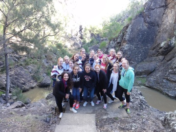 The immersion group poses for a photo at Kinbombi Falls